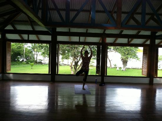 A partcipant is practicing Tree pose in Blue Osa