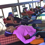 Participants are relaxing in Marianne Wells Yoga School