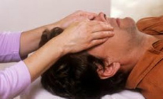 man getting reiki healing