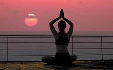 woman doing yoga during sunset