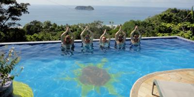 people doing yoga in a swimming pool