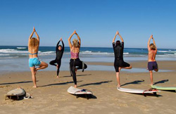 practicing yoga on surfing boats