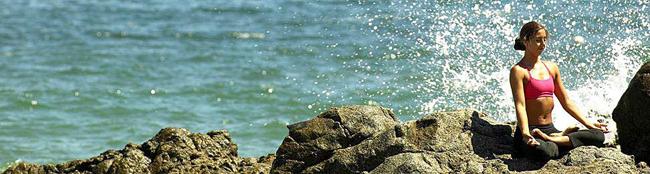 woman meditating beside sea beach