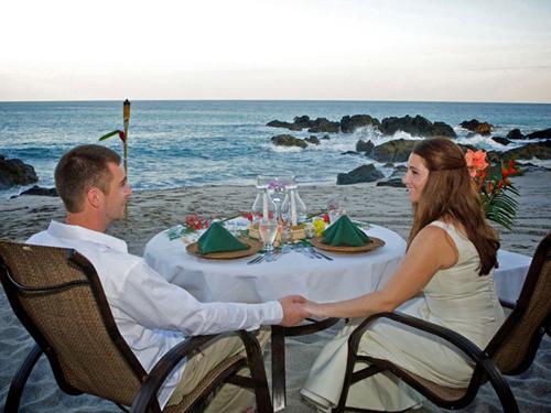 couple having launch beside sea beach