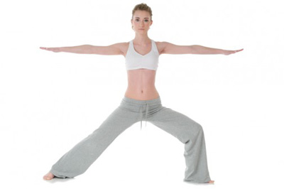woman practicing warrior pose