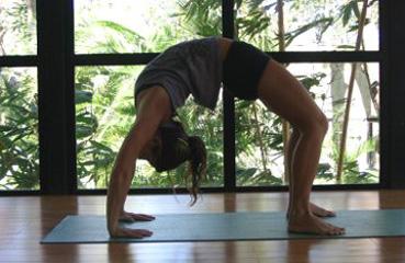 woman practicing chakrasana