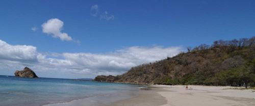 Beautiful Bahia Salinas sea beach under brilliant blue sky