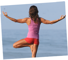 woman doing yoga in front of deep blue sea