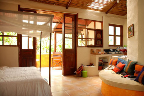 Bed room with kitchen and king size bed at Rio Chirripo Yoga Retreat Rooms