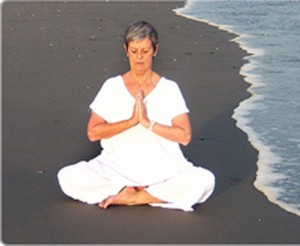 woman practicing meditation at sea beach