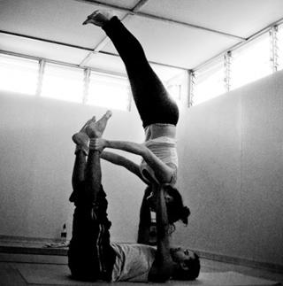practicing couple yoga at zen yoga studio