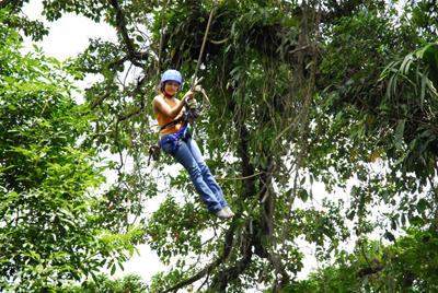 beautifull woman having fun at Arenal Ecoglide Park