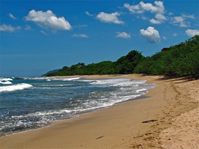 a beautiful tamarindo sea beach under the blue sky