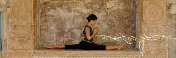 woman doing ashtanga yoga on concret base