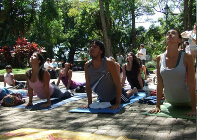 group of people practicing outdoor yoga