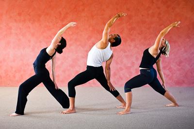 people practicing vinyasa flow yoga