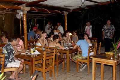 people enjoying dinner at beach dog cafe