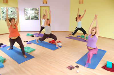 women practicing warrior pose
