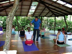 group of people practicing yoga with instructor