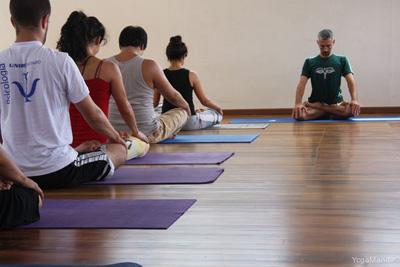 group of people practicing pranayama