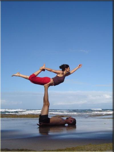 couple practicing practicing partner yoga at yoga mandir