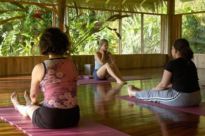 students practicing janushirasana