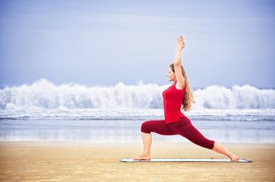 woman practicing warrior pose