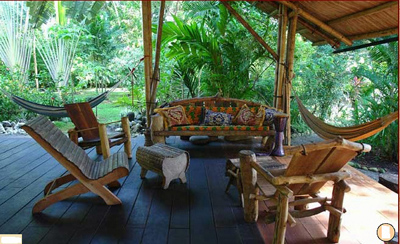 wooden deck with hammock and chairs