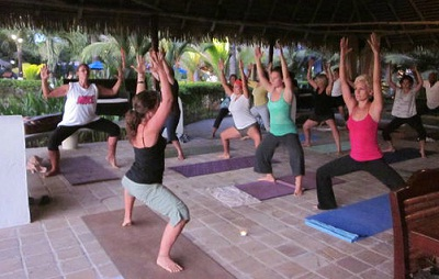 group of people practicing hatha yoga