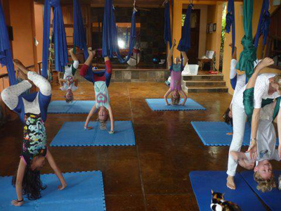 kids practicing aerial yoga