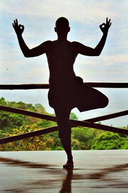 Man practicing tree pose