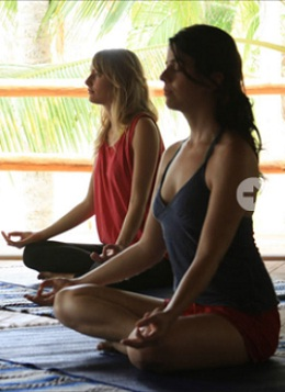 Women practicing meditation