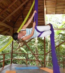 Woman-doing-aerial-yoga-at-